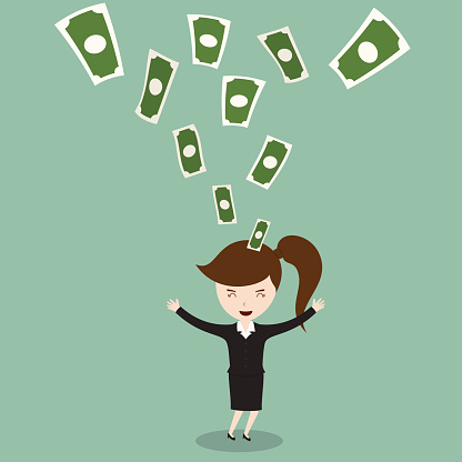 Happy young businesswoman enjoying money rain.